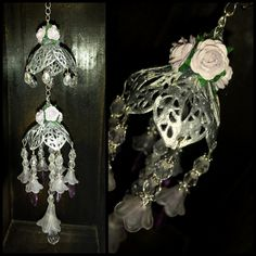 Chandelier made from filigrees (silver embossed), beads and flowers.  Products are available from www.my2angels.net