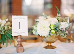 Ivory and Bronze Wedding Centerpiece | photography by http://jenhuangphoto.com/