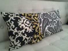 Cojin moderno con mezcla de telas