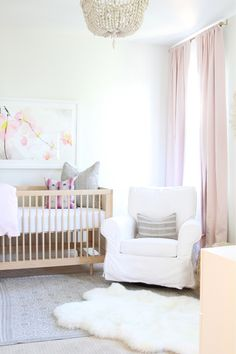Add a floral touch to your little one's gold and pink themed nursery with a wall art print from Minted.
