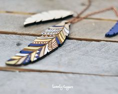 Wood native pendant  feather laser cut by TheTwentyFingers on Etsy, $16.50
