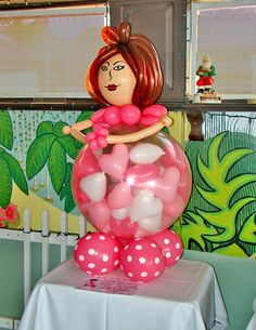 Baby shower game: guess how many balloons/hearts inside mama's belly.