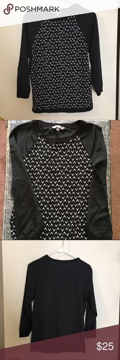 """Daisy Fuentes long sleeve top Daisy Fuentes long sleeve top. Chiffon type material throughout with soft """"sweatshirt-like"""" material around the neck, bottom and sleeve cuffs. Plain black back with white pattern on the front. Reasonable offers are always welcome. Daisy Fuentes Tops"""