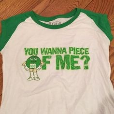 M&M short sleeve white t-shirt w/ green sleeves You wanna a piece of me. Green M&M t- shirt. White shirt with green sleeves. Size small. Worn one time by myself.#1301 M&M Tops Tees - Short Sleeve