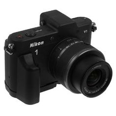 Fotodiox Pro, All Metal Black Camera Grip for Nikon 1 V1 Mirrorless Camera with Battery Access -- makes the camera more comfortable to hold. This one is cheaper, more solid, and more convenient than the Nikon model (GR-N1000)