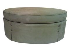 cool...Overlain Ottoman - Dering Hall...$750 check with Klingman's for alternative...round is a nice contrast of shape