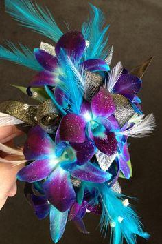Blue Bom Orchid corsage justrosespluscda.com I love the purple and blue orchids light blue feather