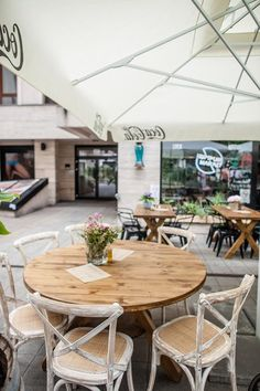 RESTAURANTS - Hummus Market Budapest  A new Israeli restaurant with great dishes in a cozy environment.  Vintage style abraded wooden armchairs and black aluminum armchairs are waiting for you to take a seat and enjoy your supper. #steel #tablebase #contractfurniture #horecafurniture