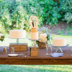 I like the idea of having 3 smaller cakes because it is probably less expensive. I would want metallic cake stands though. Trio of white wedding cakes White Wedding Cakes, Wedding Cupcakes, Wedding Favors, Wedding Ideas, Wedding Bells, Wedding Decor, Wedding Table Centerpieces, Flower Centerpieces, Centerpiece Ideas