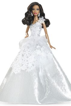 Dazzle at any special occasion this holiday season in a snow-tastic, one-of-a-kind stunner! 2013- Holiday Barbie™ Doll - African American.