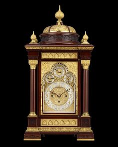 Moorish Mantel Clock by Tiffany & Co.~ An incredible example of American clockmaking, this Tiffany & Co. mahogany and gilt bronze mantel clock is a shining example of the firm's outstanding artistry in decorative metalwork. The timepiece is embellished with chased designs in a Moorish motif, including repeating trefoil patterns, sunburst engravings on each dial, Corinthian capitals and a domed topper with onion finials. ~M.S. Rau Moorish Revival, Clocks For Sale, Antique Clocks, Corinthian, Quality Time, Metal Working, Onion, Tiffany, Bronze