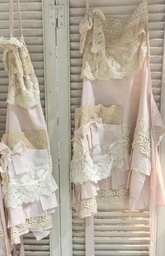 Designed by Miss Rose Sister Violet this is no ordinary apron. Made with linen and adorned with lace in creams and coffee across the bodice and pleated skirt, it has an extra large decorative and very useful pocket with 4 compartments. This is really an article of clothing to be