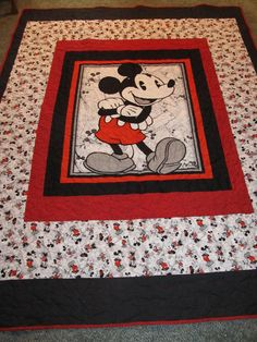 This Mickey Mouse Quilt will fit a Twin size bed. It is adorable with Mickey done in reds and blacks and matching panel and bordered with Matching Mickey Fabric. The back is done in a black and white fabric with leaves and Black fabric to match the front black.(See pictures to see picture) The quilt is done with all Cotton Fabrics. The size is 68 x 87. A great size for a Twin Bed. All Mickey and Disney Lovers will fall in love with this quilt. It is quilted on a long arm Machine in a...