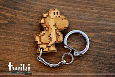 Laser cut and engraved Yoshi 8 bit wood keyring. By TwikiConcept on Etsy