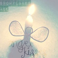 Snowflakes are angel kisses <3 Beautiful candle we received from the hospital after my baby girl passed away; been waiting for the right time to light it.