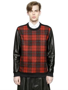 GIVENCHY TARTAN WOOL & LEATHER SWEATSHIRT £1290.00 on luisaviaroma (2014)  Ribbed collar, cuffs and hem Tartan front panel Leather sleeves with zip cuffs Sample size: M 96%WO2%PA2%CALF