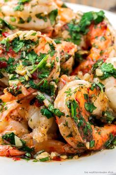 A top Mediterranean recipe that will win you over! Shrimp charred and dressed in a roasted garlic-cilantro sauce with a hint of chili, white wine and lemon juice! Great appetizer or serve it for dinner with rice or your a favorite pasta!