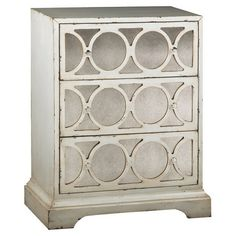 Reminiscent of Old Hollywood style, this weathered chest features 3 drawers with circular fretwork overlay.   Product: Chest