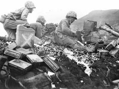 Iwo Jima was prime real estate for Americans to launch air raids against Japan, but the island was heavily guarded by Japanese forces. Marines are seen here battling at the foot of Mount Suribachi.