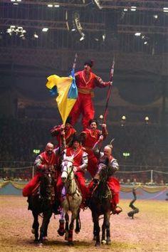 The Ukrainian Cossacks perform during the London International Horse Show at the Olympia Exhibition Centre, London, Thursday Dec. 16, 2010. (AP Photo/