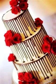 Valentine's day wedding decoration in 2014, Wicked chocolate wedding cake iced in white chocolate, decorated with fresh red roses