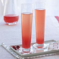 Poinsettia Punch - 1 bottle Champagne, chilled, 3 cups cranberry-apple juice, chilled, 1/4 cup thawed white grape juice concentrate, 1/4 cup orange liqueur