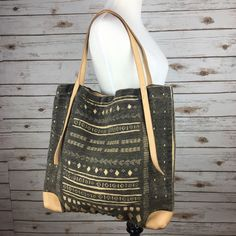 "[Free People] Boho Tribal Pattern Tote Bag Gym Large tote bag is perfect, for school, the gym, or everyday errands. Lightweight with vegan leather trim. Snap closure. Small inside zip pocket.  Color: Black & Tan Dimensions: 17"" Wide x 16"" Tall Strap Drop: 11"" Condition: NWT!  No Trades! Free People Bags Totes"