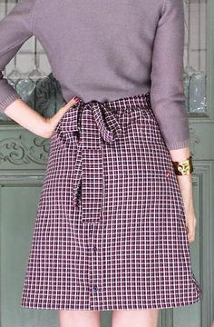 Turn your hubby's old button down into a chic a-line skirt for fall with this Plaid Button Down Skirt Refashion tutorial. It's the perfect skirt for autumn!