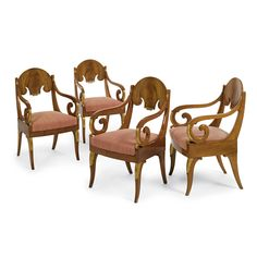 A set of four Baltic Neoclassical parcel-gilt carved mahogany armchairs, first quarter 19th century.