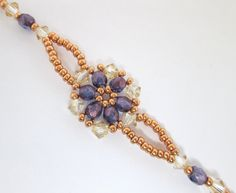 A charming little floral bracelet using crystal golden shadow swarovski bicones, czech glass firepolish beads in violet lustre and muscat