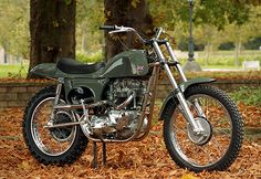 Steve McQueen's most famous motorcycle has been recreated by the Rickman Brothers, legendary themselves within the moto fraternity. The gearbox and engine are period Triumph TR6, with a single Amal carb, set in a Mk III Métisse frame. Forks are 35mm Cerianis with over seven inches of travel: BSA yokes position the handlebar behind the steering stem for better control. Wheel rims and exhausts are chromed, and the rear shocks are authentic Girling reproductions.