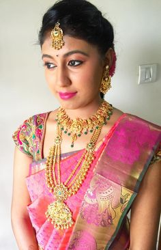 Traditional Southern Indian bride wearing bridal silk saree and jewellery. Engagement look. Makeup and hairstyle by Swank Studio. #BridalSareeBlouse #SariBlouseDesign  Silk kanchipuram sari. Braid with fresh flowers. Tamil bride. Telugu bride. Kannada bride. Hindu bride. Malayalee bride  Find us at https://www.facebook.com/SwankStudioBangalore