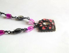 Pink, black abstract polymer clay necklace with glass beads.