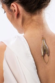Naomi Kizhner is an industrial designer who has seen the dark side of humanity's future, and is preparing for a future without electricity by creating unusual pieces of invasive jewelry meant to harvest kinetic energy from the human body.