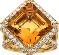 Citrine, Yellow Sapphire, Diamond, Gold Ring The ring features a rectangular-shaped citrine measuring 14.15 x 13.80 x 9.10 mm and weighing 12.34 carats, enhanced by round-shaped yellow sapphires weighing a total of 1.77 carats, accented by full-cut diamonds weighing a total of 1.56 carats, set in 18k gold.
