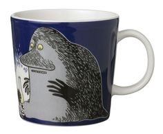 """This dark blue Moomin mug by Arabia from 2005 features the Groke looking at a night light. It's beautifully illustrated by Arabia artist Tove Slotte-Elevant and the illustration can be seen in the original book """"Moominland Midwinter"""" by Tove Jansson. Moomin Shop, Moomin Mugs, Porcelain Mugs, Ceramic Cups, Tove Jansson, Tea Cup Set, Tea Art, Mug Cup, Mug Designs"""
