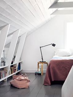 white attic space with shelving