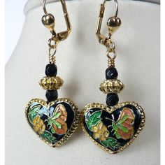 @Overstock.com - 'Willow' Cloisonne Heart Dangle Earrings - These playful light-weight dangle earrings feature gilt-edged cloisonne hearts with flower and butterfly motif. Czech fire-polished faceted jet glass beads, antiqued gold-finished pewter double dot rondelles and leverback earwires finish the look.  http://www.overstock.com/Main-Street-Revolution/Willow-Cloisonne-Heart-Dangle-Earrings/7665310/product.html?CID=214117 $15.99