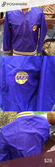 """Vintage LA Lakers Mens Pullover Jacket Size Small Size Small. No Brand tag. Measures: shoulder to shoulder: 17"""". Pit to pit: 20"""". Bottom of the collar in the back to the bottom of the jacket: 25"""". 1/2 Zip Pullover. Be sure to view the other items in our closet. We offer both women's and Mens items in a variety of sizes. Bundle and save!! Thank you for viewing our item!! . Jackets & Coats Lightweight & Shirt Jackets"""