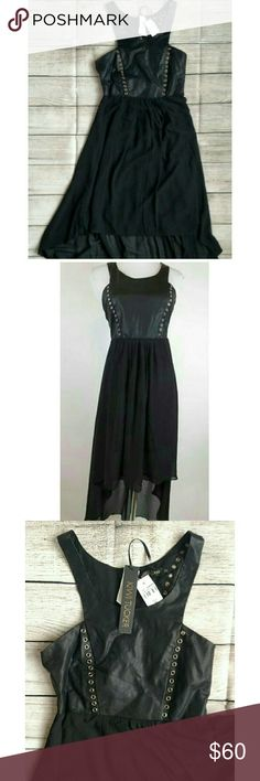 "NWT LF Kiwi Tucker leather lace hi lo dress. XS This dress is gorgeous! Faux leather top and hi lo lined sheer bottom. Strappy open back. Very sexy. Length 37"" front and 52"" back Armpit to armpit 15"" Waist 27"" LF Dresses High Low"