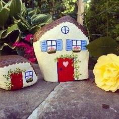 Little houses.  I had so much fun painting these. Need to find more stones to…