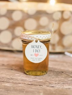 """Honey, I do!"" Adorable honey jars created by the bride for favors."