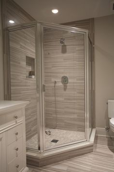 Chrome Framed Neo Angle Shower Enclosure with Clear Glass Door Installed by Innovative Closet Designs in New Jersey.  www.icdnj.com