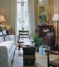 I love this little sitting room. Living room lux layers sisal rug antique furniture, curtains, French doors, door hardware, iron lock hardware for French doors, sofa, sofa upholstery fabric, southern, southern home decor traditional decor southern interior design concepts classic interior