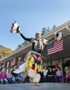 """Street Chiefs and dancers perform on curbside stages outside shops in Cherokee, NC. It's a tradition that began years ago with the late Chief Henry, who was once billed as """"The World's Most Photographed Indian."""