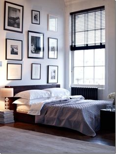 monochromatic gallery wall adds focal point in modern bedroom