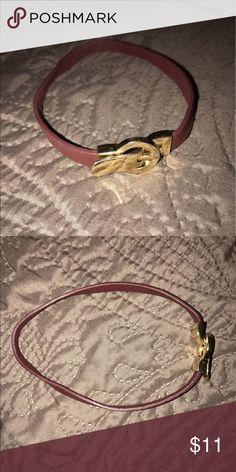 Maroon/gold faux leather choker with buckle NWOT Maroon faux leather choker with buckle fastener. NWOT Jewelry Necklaces