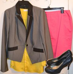 A pink skirt with a yellow blouse and a color blocked blazer with simple black pumps.