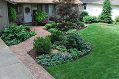 Stamped concrete walk leads through a front entry garden.