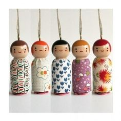 Window shopping from bed - love it! How adorable are these handpainted wooden doll necklaces with little rubber stamps on the bottom.